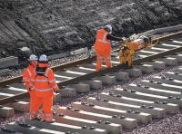 Rail clips being applied to newly laid track at Shawfair on 7 October 2014.<br><br>[Bill Roberton&nbsp;07/10/2014]