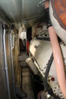 Taken from the mid point of the locomotive, this is the view towards the No.2 cab of <I>Deltic</I> alongside one of the two Napier 2-stroke engines. The low ceiling panels conceal the roof mounted water tanks feeding the steam heating boiler alongside the camera. In the confined space of the passageways on either side of the engines one could only sympathise with the travelling engineer who's working environment this was and speculate on the noise levels when the Napiers were under power.   <br><br>[Mark Bartlett&nbsp;04/10/2014]