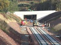 The new bridge providing farm access from the B6367 just north of the former Tynehead station. Seen here on 5 October 2014 with a construction machine crossing carrying a load of pipes.<br><br>[John Furnevel&nbsp;05/10/2014]