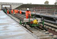 Tracklaying taking place on the down line through Shawfair station on 9 October 2014 as part of a media event. GBRf 66706 <I>Nene Valley</I> is at the north end of the train.<br><br>[John Furnevel&nbsp;09/10/2014]