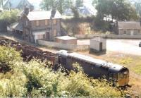 Another photograph showing a down recovery train passing through Gorebridge in the late summer of 1971 behind an unidentified class 26 locomotive. [See image 48975]<br><br>[Neil Hay/Stuart Hay Collection (Courtesy David Spaven)&nbsp;//1971]