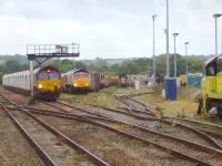 View over Westbury Yard during the late morning of 29 August 2014. Present from left to right are a DB class 66 on a rake of lifting roof car carrier wagons, GBRF 66752 <I>The Hoosier State</I> with an infrastructure train, a DB class 08 shunter, a Freightliner class 66, and Colas Railfreight 70809. <br><br>[David Pesterfield&nbsp;29/08/2014]