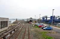 A general view of Stranraer Station looking inland in April 2014, also visible is part of the once busy ferry terminal, now closed and completely fenced off.<br><br>[John Gray&nbsp;30/04/2014]