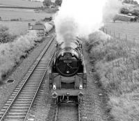 BR Standard class 9F 92220 working <I>The Lord Bishop</I> between Appleby and Armathwaite on 30 September 1978. Thought to have been taken where the B6412 crosses over the S&C about a mile and a half south of Langwathby (?)<br><br>[Bill Jamieson&nbsp;30/09/1978]