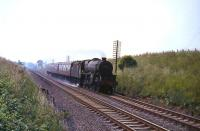 Stirling based Black 5 no 45214 approaching Cumbernauld with a train on 3 August 1965.<br><br>[G W Robin&nbsp;03/08/1965]