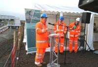 Part of the formal proceedings at the Borders Railway tracklaying event at Shawfair on 9 October 2014. Left to right are Scotland's Transport Minister Keith Brown, Network Rail CEO Mark Carne and Borders Railway Project Director Hugh Wark. Another key contributor on this damp and chilly morning is the gentleman on the far right just inside the marquee, busy preparing coffee and the best bacon rolls ever...<br><br>[John Furnevel&nbsp;09/10/2014]