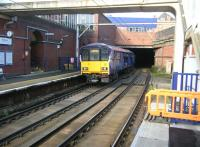 The 1104 Motherwell - Milngavie Argyle Line service leaves Bridgeton on Sunday morning 12 October 2014 and disappears into the 460 yard Canning Street Tunnel towards Glasgow Green.<br><br>[Veronica Clibbery&nbsp;12/10/2014]