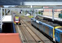 A VR Vlocity DMU leaves Sunbury for Melbourne on 30 September while a Metro EMU stands at the other platform. The whole station has been transformed by electrification. [See image 41779]<br><br>[Colin Miller&nbsp;30/09/2014]