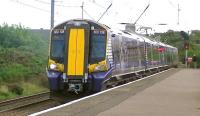 The 1218 Glasgow Central - Ardrossan Harbour formed by Scotrail EMU 380108 calls at Ardrossan South Beach on 13 August 2014.<br><br>[Ken Browne&nbsp;13/08/2014]