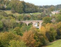 Never looks quite the same twice. The valley of the North Esk and a small section of Lasswade Viaduct. The 1867 viaduct, designed by Thomas Bouch, once carried the Polton branch, which closed to passengers in 1951 and to all traffic in 1964. Photographed mid morning on 9 October 2014 looking north, with Autumn starting to make its mark on the landscape. <br><br>[John Furnevel&nbsp;09/10/2014]