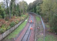 The advance guard of the Borders Railway tracklaying train drops rails into place just south of Kingsgate Points in the early afternoon of Monday 13th October. [See image 38706]<br><br>[David Spaven&nbsp;13/10/2014]