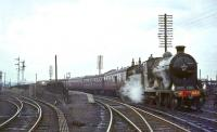NB 256 <I>Glen Douglas</I> photographed at Bathgate on 30 March 1964 with the SLS <I>Scottish Rambler no 3</I> during a water stop on its way to Edinburgh.<br><br>[John Robin&nbsp;30/03/1964]