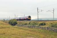 Part way down the long descent of Shap Bank, TPE 350410 passes Scout Green on 19 September with a service from Scotland to Manchester Airport. <br><br>[Mark Bartlett&nbsp;19/09/2014]