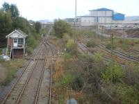 View east from Belasis Avenue overbridge along the line to Port Clarence on 15 October 2014. The operational Belasis Lane signal box controls the end of the twin track section from the junction with the main line south of Billingham station and access to the disused sidings to the right, serving the Haverton Hill chemical complex. [Security staff then arrived to question me as to what I was photographing, as it is seemingly forbidden to take views of the chemical plant.] <br><br>[David Pesterfield&nbsp;15/10/2014]