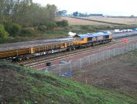 The Borders Railway tracklaying train operating just to the north of Shawfair station on 9 October 2014. The locomotive is GBRf 66706 <I>Nene Valley</I>.  <br><br>[John Furnevel&nbsp;09/10/2014]