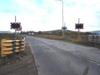 Looking east across the disused and non operational Huntsman Drive level crossing at Port Clarence on 15 October. The crossing is on the section of line running north to the Seal Sands chemical complex from the spur into the 'Greenergy' fuel terminal loading sidings. <br><br>[David Pesterfield&nbsp;15/10/2014]