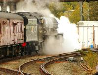 Preserved Jubilee 4-6-0 no 45690 <I>Leander</I> takes the Hellifield line as it sets off past Carnforth Station Junction signal box on 16 October 2014 during a test run.<br><br>[John McIntyre&nbsp;16/10/2014]