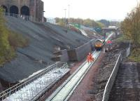 View south at Newtongrange on 14 October 2014 during tracklaying operations, showing the short distance between the Lady Victoria Colliery site, home of the Scottish Mining Museum (top left) and the under construction platform. The new station will have a direct footpath link with the museum. <br><br>[John Furnevel&nbsp;17/10/2014]