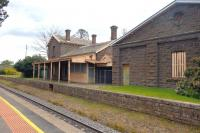 The rather spooky looking disused main building and large goods shed on the single track part of the Melbourne - Bendigo line in September 2014. The station is still open with a reasonable train service in both directions.<br><br>[Colin Miller&nbsp;30/09/2014]