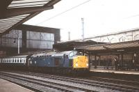 EE Type 4 40012 (formerly D212) at Carlisle with an up WCML train in August 1979. Withdrawn from main line service by BR in February 1985 the locomotive was reinstated 3 months later as departmental 97407 for use on the Crewe area remodelling project. After final withdrawal in April 1986 the loco was purchased for preservation in 1988. [See image 23791].<br><br>[Peter Todd&nbsp;/08/1979]