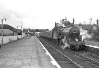 Crab 2-6-0 no 42737 stands at the up platform in Beattock station on 29 March 1964 with the SLS <I>'Scottish Rambler No 3'</I> railtour. At the other end of the train standard 2-6-4 tank 80118 is coupling up in readiness for the short trip to Moffat. [See image 30082]<br><br>[John Robin&nbsp;29/03/1964]
