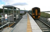 DMU 158826 leaves the almost finished new station at Llandecwyn on 14th October 2014 for Birmingham International. Although some work remains to be done on approaches and handrails, the new station opened for business along with the reconstructed Pont Briwet in September 2014.<br><br>[Colin McDonald&nbsp;14/10/2014]