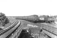 A DMU approaches Cathcart station from the Mount Florida direction on 16 May 1960. The goods yard stands on the right and the train is about to cross over Old Castle Road to reach the platform. [The subsequently extended island platform here now reaches a point some distance beyond the gap.]<br><br>[G H Robin collection by courtesy of the Mitchell Library, Glasgow&nbsp;16/05/1960]