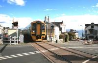 The 1259 service to Pwllheli approaches the level crossing in Criccieth on a sunny 14th October 2014.<br><br>[Colin McDonald&nbsp;14/10/2014]