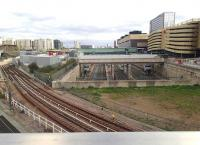 View east from Olympic Park Avenue over Stratford International station on 18 September 2014. In the foreground the Docklands Light Railway lines run towards the terminus on the upper left. Just out of shot immediately below the camera is the freight only link from the North London Line at Channelsea North Jct through to Temple Mills East Jct via the tunnel under the Olympic Village.<br><br>[John Thorn&nbsp;18/09/2014]