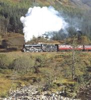 The  motion and wheels of 45407 reflect a nice glint as the Black 5 climbs away from Glenfinnan towards the summit between Lochs Eil and Eilt with the westbound <I>Jacobite</I> on 15 October 2014. Photographed across the Abhainn Shlatach about a mile west of Glenfinnan station.<br><br>[Bill Jamieson&nbsp;15/10/2014]