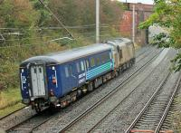 Light work for a Type 3. A very grubby DRS 37409 <I>'Lord Hinton'</I>, presumably on a break from Sandite duties, takes a much cleaner MkII Brake from Kingmoor to Crewe Gresty Bridge through Hest Bank on 22nd October. <br><br>[Mark Bartlett&nbsp;22/10/2014]