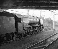 46233 <I>Duchess of Sutherland</I> has left the stock of the <I>Cumbrian Mountain Express</I> in the sidings at Carlisle on 6 September and is moving forward under Victoria Viaduct prior to reversing down to Upperby for servicing.<br><br>[Bill Jamieson&nbsp;06/09/2014]