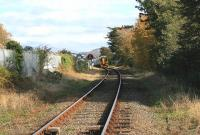 DMU 158834, destined for Birmingham International, passes the former goods yard at Criccieth on 14 October and descends towards the level crossing near the Esplanade.<br><br>[Colin McDonald&nbsp;14/10/2014]
