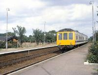 A Yorkshire Coast Line DMU southbound through Nafferton station in the summer of 1980 on its way to Hull.<br><br>[Peter Todd&nbsp;18/08/1980]