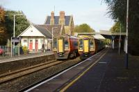Autumn in Dorset, as a pair of SWT 159 units meets at Sherborne station on 20 October 2014. Left is 159014 on an Exeter to Waterloo train, while 159021 is operating the reverse service.<br><br>[John McIntyre&nbsp;20/10/2014]