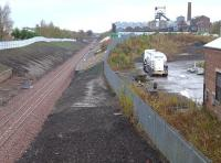 Looking north to the former Lady Victoria Colliery (now the Scottish Mining Museum) on 27 October, with Newtongrange station in the background.  The tanker lorry is parked on what was the NCB loco shed yard, with the shed itself surviving on the right in industrial use.<br><br>[Bill Roberton&nbsp;27/10/2014]