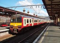 320304, in SPT carmine and cream livery, pauses at Dumbarton Central with an eastbound service in April 2008. <br><br>[Mark Bartlett&nbsp;17/04/2008]