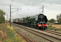 With its exhaust clinging to the boiler 46233 <I>Duchess of Sutherland</I> forges north at Brock on 25 October with the <I>Appleby Explorer.</I> The Pacific hauled the train from Crewe direct to Appleby via Shap avoiding Carlisle by using the curve at Upperby. <br><br>[Mark Bartlett&nbsp;25/10/2014]