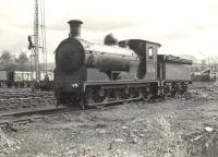 J36 0-6-0 no 65296 stands in the yard at Balloch in April 1957. Balloch shed (BR code 65I) closed in November 1960 only to be reopened shortly thereafter due to problems with the new electric <I>'Blue Trains'</I>. The shed closed for the second and final time in September 1961. [See image 32327]<br><br>[G H Robin collection by courtesy of the Mitchell Library, Glasgow&nbsp;20/04/1957]