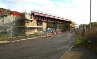 The new railway bridge under construction spanning Currie Road, Galashiels. Photographed on 24 October 2014 looking south east towards Tweedbank, with the Eildon Hills visible in the right background. <br><br>[John Furnevel&nbsp;24/10/2014]