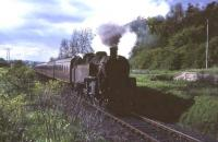 An unidentified BR Standard 2-6-4 tank about to enter Thorntonhall station in June 1965 with the 5.33pm from St Enoch.<br><br>[G W Robin&nbsp;/06/1965]