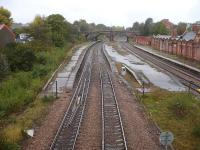 Looking north over the almost intact Rotherham Masborough station in October 2014 (closed October 1988), showing the passenger lines used by cross country services in the foreground and the goods lines to Chesterfield, avoiding Sheffield, over to the right. A goods loop line still exists, albeit covered in vegetation, on the far left. [See image 41035]<br><br>[David Pesterfield&nbsp;13/10/2014]