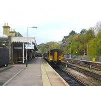 156426 is ready to leave Buxton with the 09:22 to Manchester Piccadilly and is allowed an extra 5 minutes for the journey in the leaf fall season.  The restored fanlight window which was the gable end of the original station is visible above the train [see image 31175].  Both platforms are in daily use whilst the centre road is used for the overnight stabling of Class 150 and 156 units in regular use on the line.<br><br>[Malcolm Chattwood&nbsp;31/10/2014]