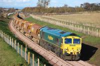 View north at Arniston towards Newtongrange on 3 November with 66610 on the rear of a returning ballast train.<br><br>[Bill Roberton 03/11/2014]