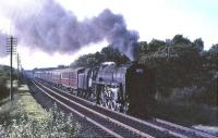 70002 <I>Geoffrey Chaucer</I> climbing through Braidwood on 16 July 1965 with a London bound relief. <br><br>[John Robin&nbsp;16/07/1965]
