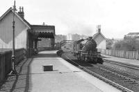 A Helensburgh - Bridgeton Central train arrives at Dalreoch on 20 April 1957 behind V1 67648. Note the Dennystown Forge to the right (north) of the station.<br><br>[G H Robin collection by courtesy of the Mitchell Library, Glasgow&nbsp;20/04/1967]