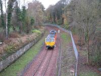 A tamping machine heads south at Kings Gate, just south of Sheriffhall, on 6th November 2014. The alignment of the original Edinburgh and Dalkeith railway trailed in from the right.<br><br>[David Spaven&nbsp;06/11/2014]