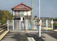 The now redundant mechanical signal box at the east end of Barry station island platform on 30 October 2014, following completion of re-signalling and transfer of control to Cardiff. The palisade fence running across the full platform in front of the box is repeated at the west end of the platform. <br><br>[David Pesterfield&nbsp;30/10/2014]