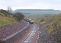 The day after reaching Scottish Borders Council territory, the rail-laying train inches south towards Falahill on 6 November 2014 - seen from the infamous Overbridge 41 [see Image 48014].<br><br>[David Spaven&nbsp;06/11/2014]