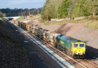 Freightliner 66610 on a ballast train just north of Tynehead station on 10 November 2014. Sister locomotive 66605 is on the other end of the train.  <br><br>[Ewan Crawford&nbsp;10/11/2014]